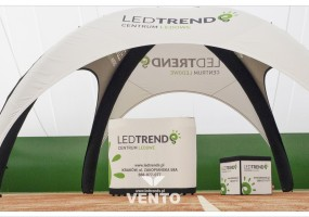 Stand made of modern VENTO tent, exhibition VENTO counter and advertising folding cube.